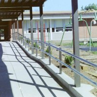 Painted aluminum posts and clear anodized aluminum horizontal railigs at Litzinger Road School