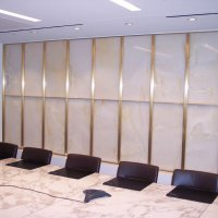 Bronze frames for Onyx wall at Bryan Cave between reception and conference